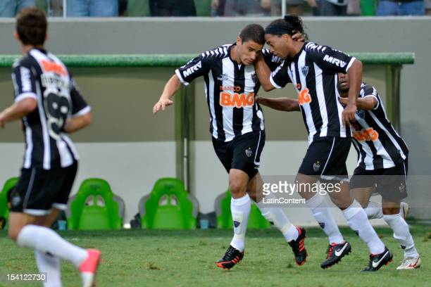 Leonardo and Ronaldinho of Atletico MG celebrate a goal during a match between Atletico MG and Sport as part of the Campeonato Brasileiro 2012 at...
