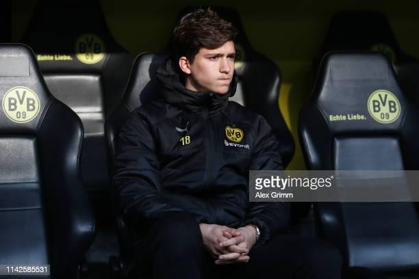 Leonardo Balerdi of Dortmund sits on the bench prior to the Bundesliga match between Borussia Dortmund and 1 FSV Mainz 05 at Signal Iduna Park on...