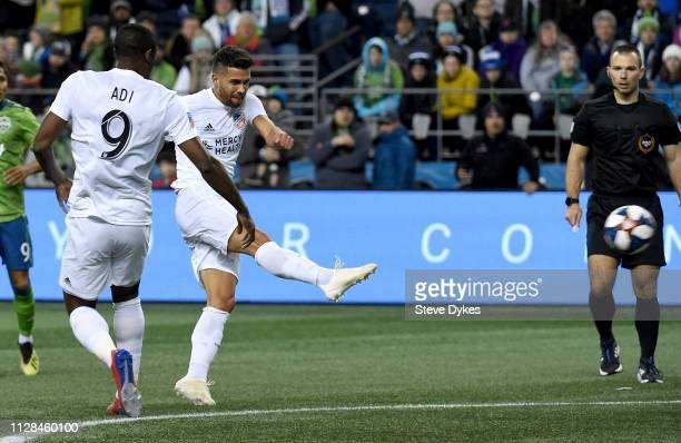 Leonardo Berton of FC Cincinnati scores a goal as Fenando Adi looks on during the first half ot the match against the Seattle Sounders at CenturyLink...