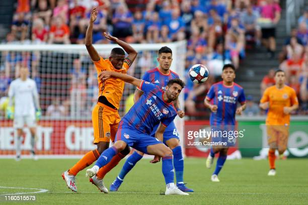 Leonardo Bertone of FC Cincinnati controls the ball against Boniek Garcia of Houston Dynamo at Nippert Stadium on July 06 2019 in Cincinnati Ohio