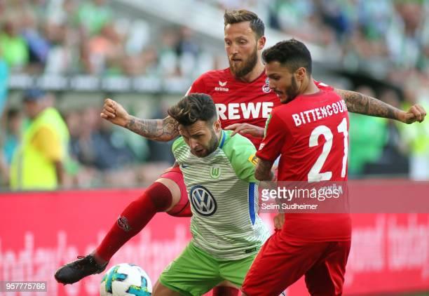 Leonardo Bittencourt and Marco Hoeger of Koeln fight for the ball with Renato Steffen of Wolfsburg during the Bundesliga match between VfL Wolfsburg...
