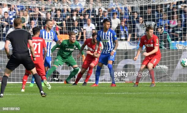 Leonardo Bittencourt of 1 FC Koeln Vedad Ibisevic of Hertha BSC Timo Horn Marco Hoeger of 1 FC Koeln Davie Selke of Hertha BSC and Dominique Heintz...
