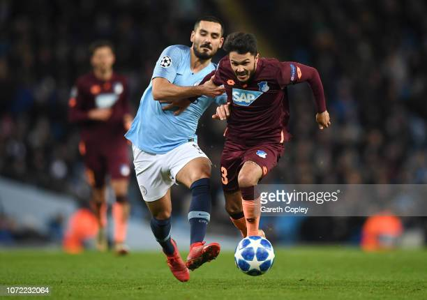 Leonardo Bittencourt of 1899 Hoffenheim is pulled back by Ilkay Gundogan of Manchester City during the UEFA Champions League Group F match between...