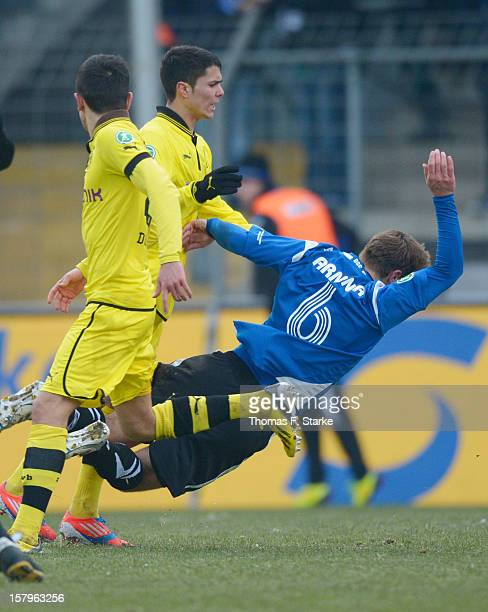 Leonardo Bittencourt of Dortmund clashes with Tom Schuetz of Bielefeld and receives a red card afterwards during the Third League match between...
