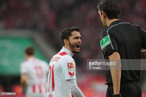 Leonardo Bittencourt of FC Koeln is upset about the yellow card he got from Referee Deniz Aytekin during the Bundesliga match between 1 FC Koeln und...
