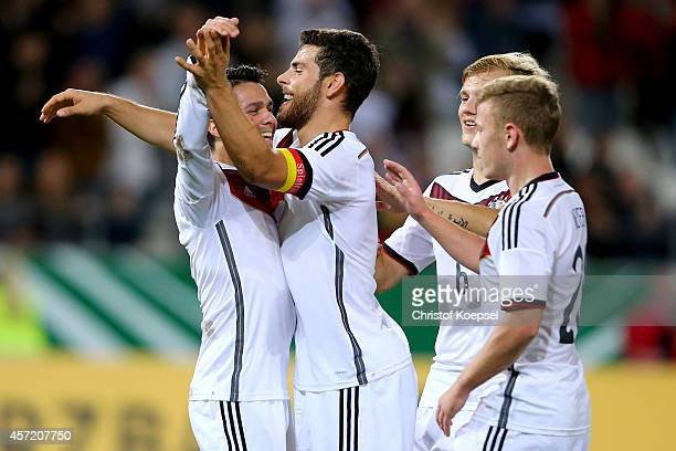 Leonardo Bittencourt of Germany celebrates the second goal with Kevin Volland Johannes Geis and Max Meyer during the UEFA U21 Championship Playoff...