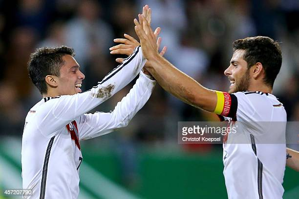 Leonardo Bittencourt of Germany celebrates the second goal with Kevin Volland during the UEFA U21 Championship Playoff second leg match between...
