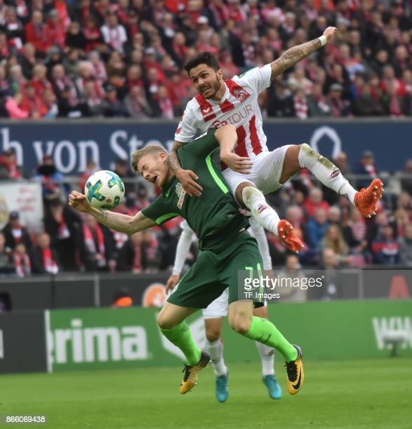 Leonardo Bittencourt of Koeln and Florian Kainz of Bremen battle for the ball during the Bundesliga match between 1 FC Koeln and SV Werder Bremen...