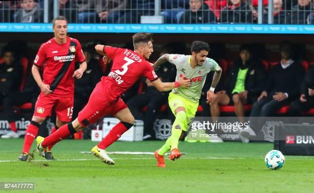 Leonardo Bittencourt of Koeln and Panagiotis Retsos of Leverkusen battle for the ball during the Bundesliga match between Bayer 04 Leverkusen and 1...