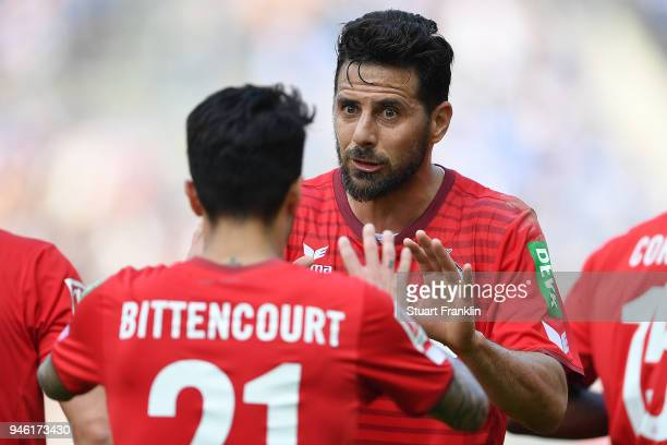 Leonardo Bittencourt of Koeln celebrates with Claudio Pizarro of Koeln after he scored a goal to make it 01 during the Bundesliga match between...