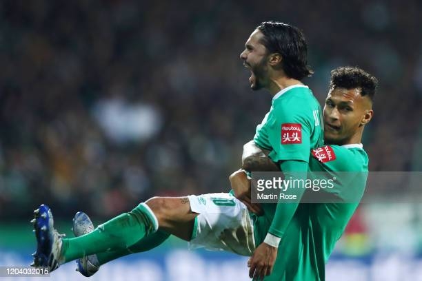 Leonardo Bittencourt of SV Werder Bremen celebrates with Davie Selke after scoring his team's second goal during the DFB Cup round of sixteen match...
