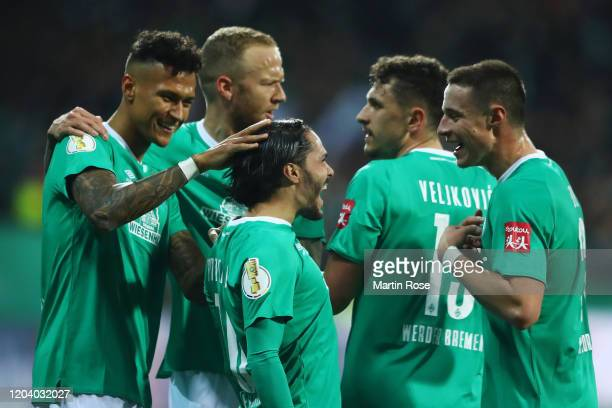 Leonardo Bittencourt of SV Werder Bremen celebrates with his team mates after scoring his team's second goal during the DFB Cup round of sixteen...