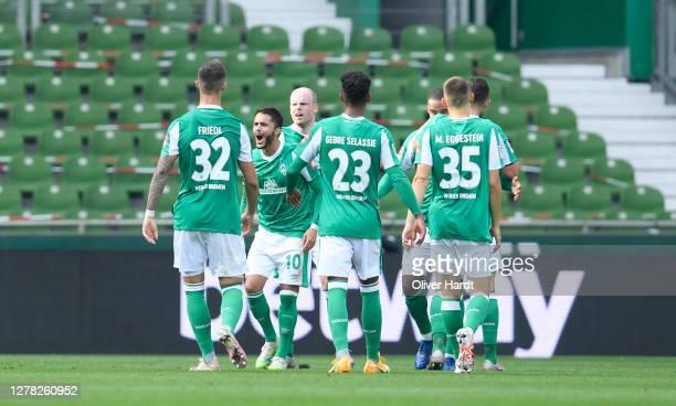 Leonardo Bittencourt of SV Werder Bremen celebrates with teammates after scoring his sides first goal during the Bundesliga match between SV Werder...
