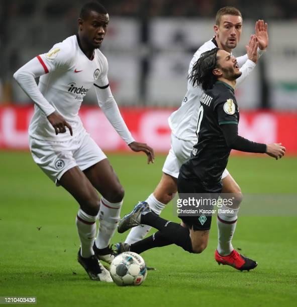 Leonardo Bittencourt of SV Werder Bremen is fouled by Martin Hinteregger of Eintracht Frankfurt during the DFB Cup quarterfinal match between...