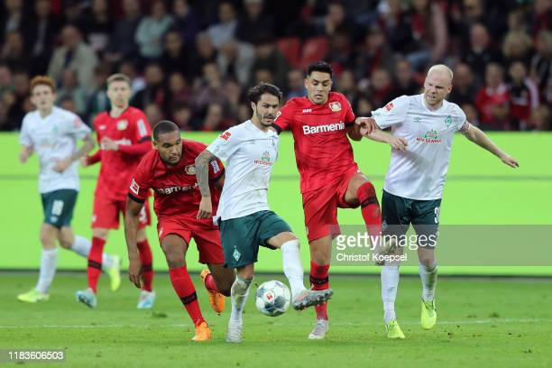 Leonardo Bittencourt of SV Werder Bremen passes the ball under pressure from Jonathan Tah of Bayer 04 Leverkusen during the Bundesliga match between...
