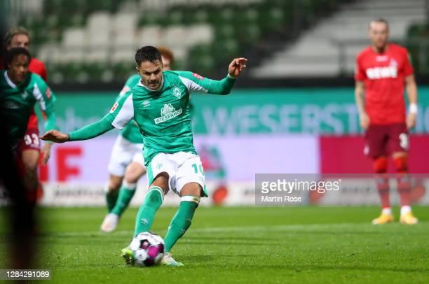 Leonardo Bittencourt of SV Werder Bremen scores a penalty for his team's first goal during the Bundesliga match between SV Werder Bremen and 1. FC...