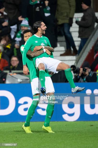 Leonardo Bittencourt of SV Werder Bremen with Davie Selke of SV Werder Bremen celebrates after scoring his team's second goal during the DFB Cup...