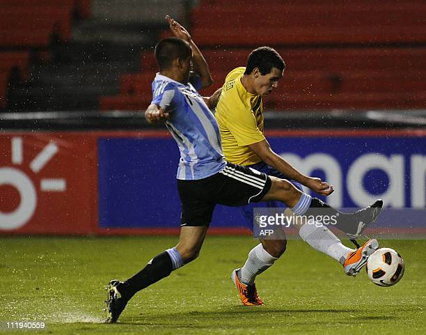 Leonardo Bonatini of Brazil vies a ball with Alexis Zara from Argentina during their Copa Sudamericana Under17 football match at the Casablanca...