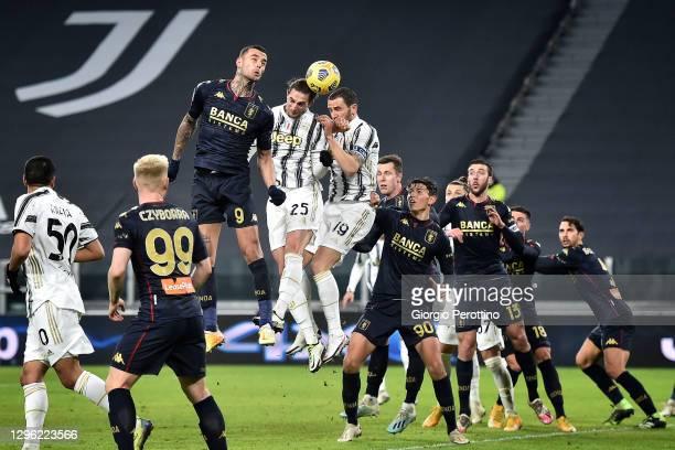 Leonardo Bonucci and Adrien Rabiot of Juventus head the ball during the Coppa Italia match between Juventus and Genoa CFC at Allianz Stadium on...