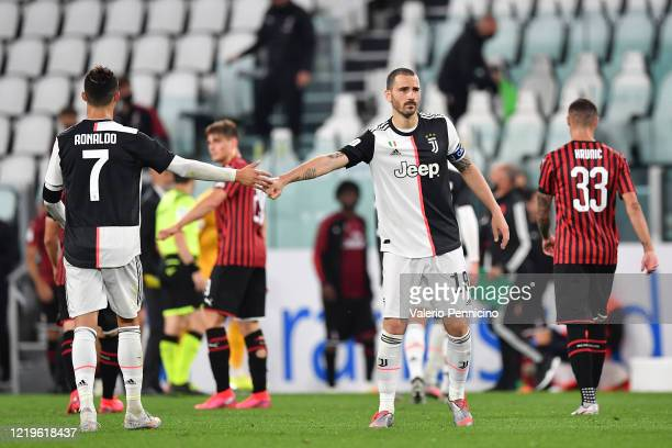 Leonardo Bonucci and Cristiano Ronaldo of Juventus celebrate at the end of the Coppa Italia SemiFinal Second Leg match between Juventus and AC Milan...