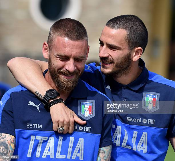 Leonardo Bonucci and Daniele De Rossi of Italy chat prior to the Italy training session at the club's training ground at Coverciano on May 27 2016 in...