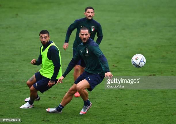 Leonardo Bonucci and Francesco Caputo of Italy compete for the ball during a training session at Centro Tecnico Federale di Coverciano on August 31,...