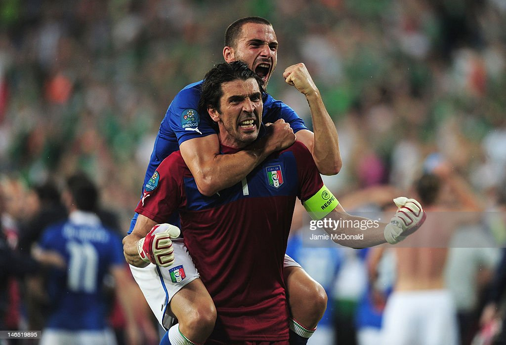 Leonardo Bonucci and Gianluigi Buffon of Italy celebrate victory and progress to the quarter finals during the UEFA EURO 2012 group C match between Italy and Ireland at The Municipal Stadium on June 18, 2012 in Poznan, Poland.
