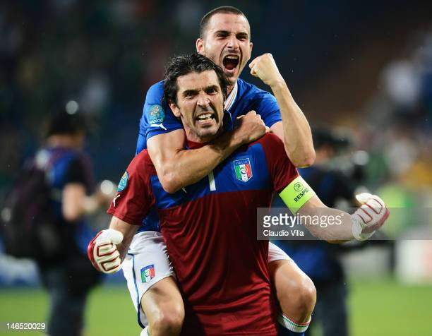 Leonardo Bonucci and Gianluigi Buffon of Italy celebrate victory and progress to the quarter finals during the UEFA EURO 2012 group C match between...
