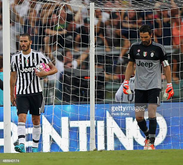Leonardo Bonucci and Gianluigi Buffon of Juventus FC react during the Serie A match between AS Roma and Juventus FC at Stadio Olimpico on August 30...