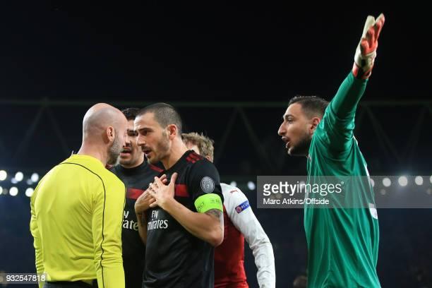 Leonardo Bonucci and Gianluigi Donnarumma of AC Milan prostest as the extra official awards penalty during the UEFA Europa League Round of 16 2nd leg...