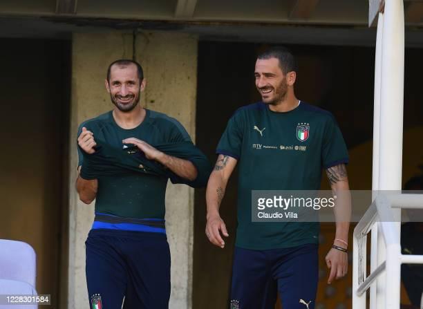 Leonardo Bonucci and Giorgio Chiellini of Italy chat during a training session at Centro Tecnico Federale di Coverciano on September 1, 2020 in...