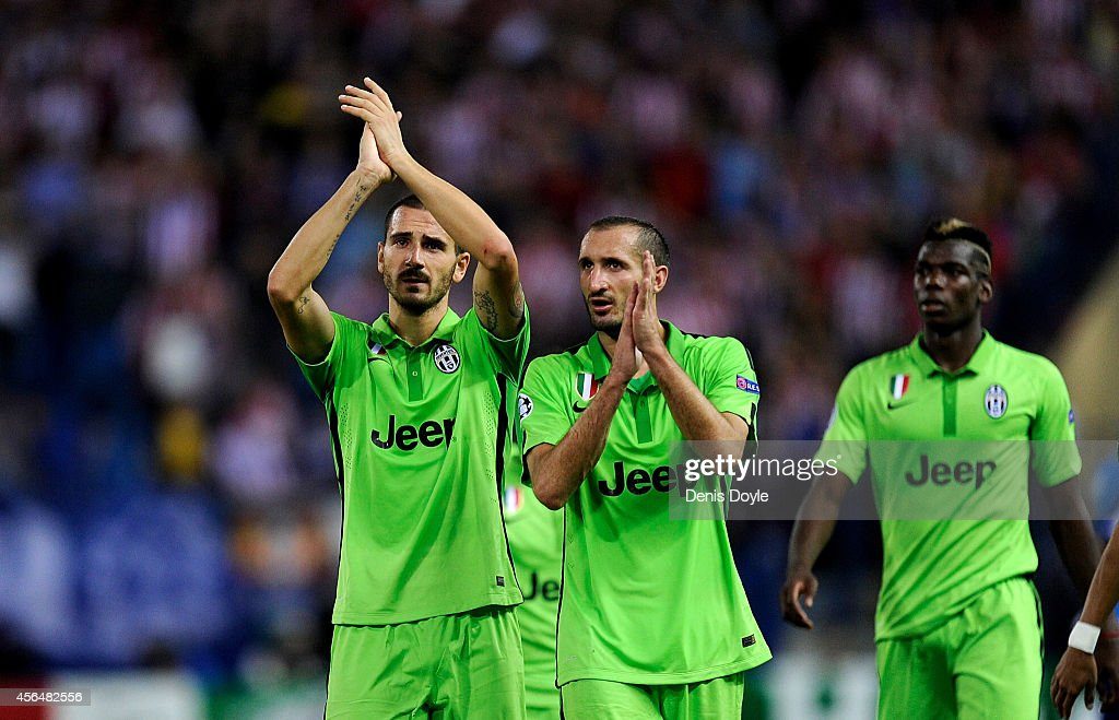 Leonardo Bonucci (L) and Giorgio Chiellini of Juventus applaud Juventus fans after losing 1-0 to Clun Atletico de Madrid during the UEFA Champions League Group A match between Club Atletico de Madrid and Juventus at Vicente Calderon Stadium on October 1, 2014 in Madrid, Spain.