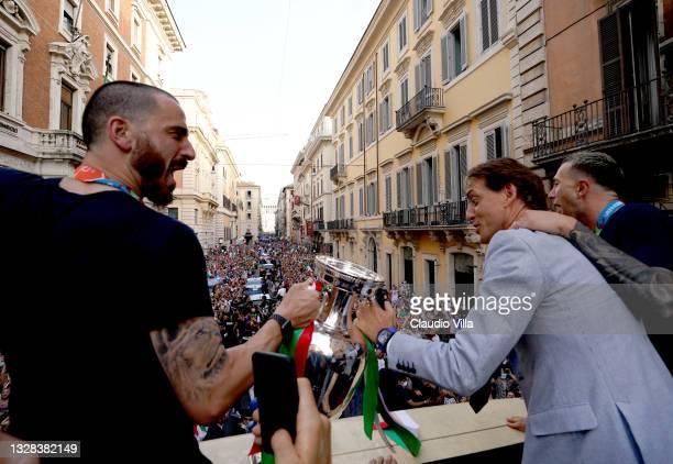 Leonardo Bonucci and Head coach Italy Roberto Mancini of Italy celebrate during Italy's national men's football team open-top bus victory parade, a...