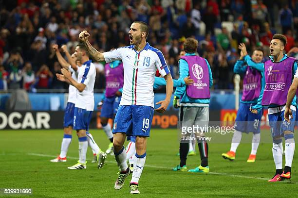 Leonardo Bonucci and Italy players celebrate their 20 win in the UEFA EURO 2016 Group E match between Belgium and Italy at Stade des Lumieres on June...