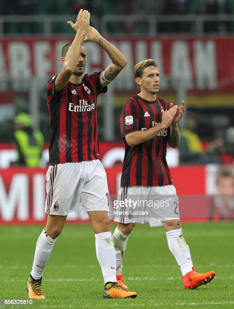 Leonardo Bonucci and Lucas Biglia of AC Milan salute the fans at the end of the Serie A match between AC Milan and AS Roma at Stadio Giuseppe Meazza...