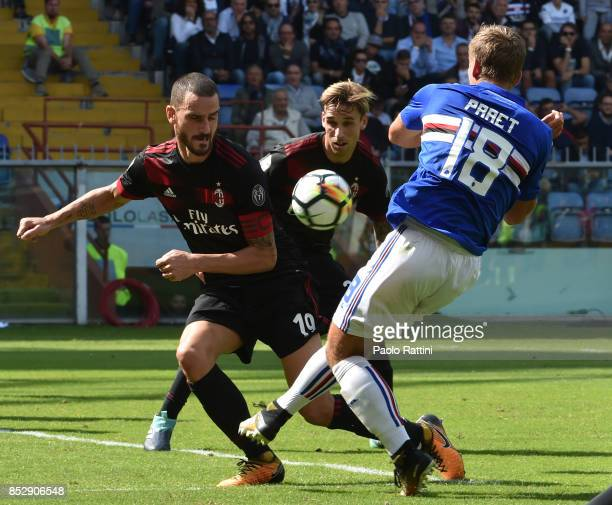 Leonardo Bonucci and Lucas Biglia of Milan in action with Dennis Praet of Sampdoria during the Serie A match between UC of Sampdoria and AC of Milan...
