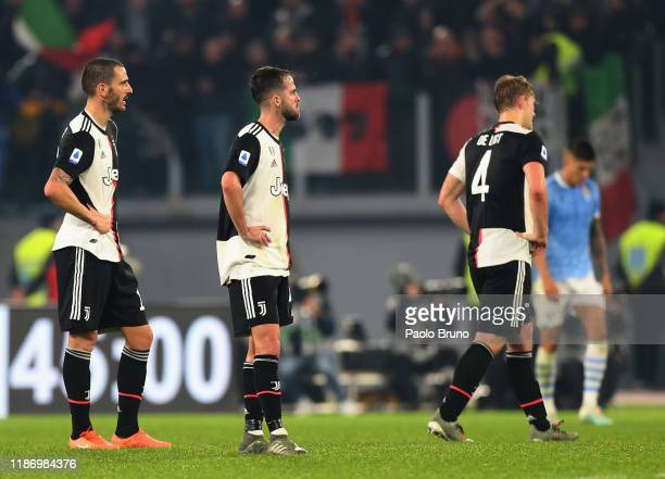 Leonardo Bonucci and Miralem Pjanic of Juventus show their dejection during the Serie A match between SS Lazio and Juventus at Stadio Olimpico on...