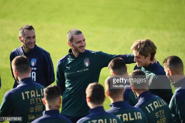 Leonardo Bonucci and Nicolo Zaniolo of Italy chat during a Italy training session at Centro Tecnico Federale di Coverciano on June 7, 2019 in...