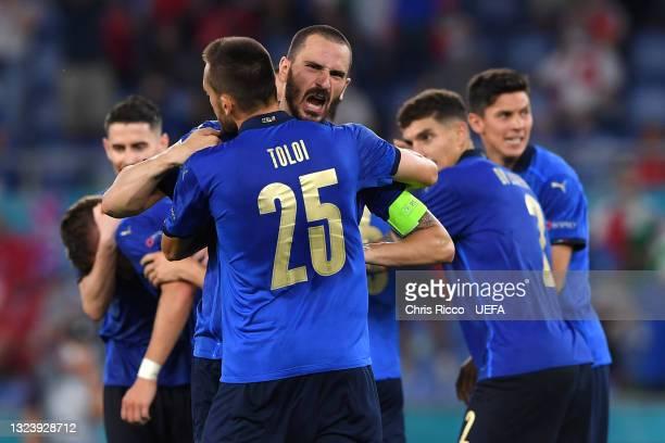 Leonardo Bonucci and Rafael Toloi of Italy celebrate their team's third goal, scored by team mate Ciro Immobile during the UEFA Euro 2020...