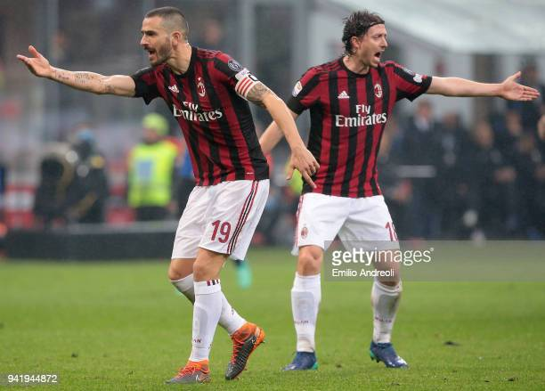 Leonardo Bonucci and Riccardo Montolivo of AC Milan react during the serie A match between AC Milan and FC Internazionale at Stadio Giuseppe Meazza...