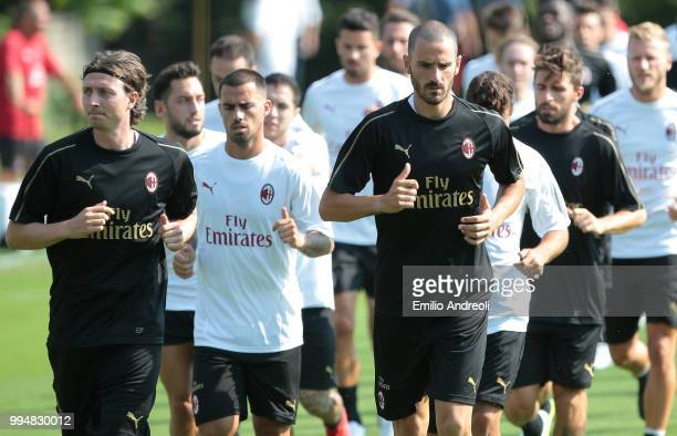 Leonardo Bonucci and Riccardo Montolivo of AC Milan train with theirs teammates during the AC Milan training session at the club's training ground...