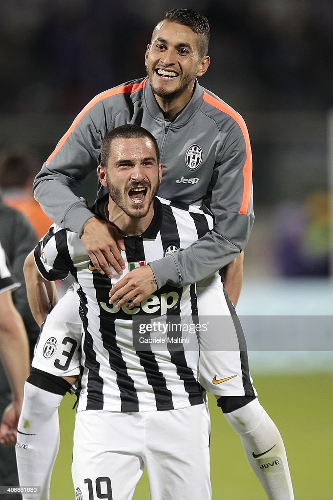 Leonardo Bonucci and Roberto Pereyra of Juventus FC celebrates the victory after the TIM cup match between ACF Fiorentina and Juventus FC at Artemio Franchi on April 7, 2015 in Florence, Italy.