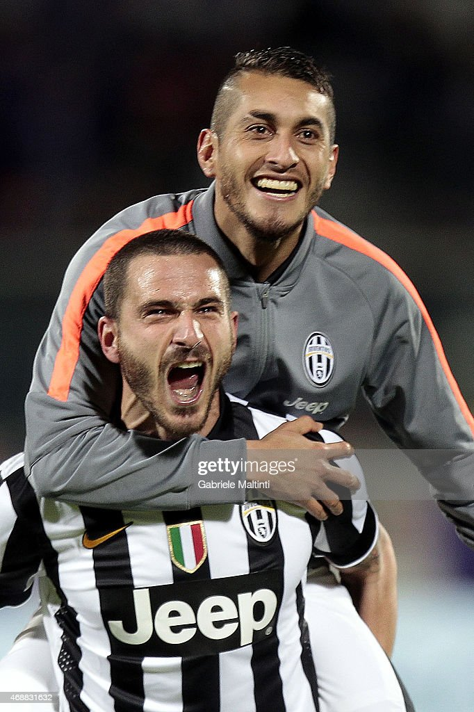 Leonardo Bonucci and Roberto Pereyra of Juventus FC celebrates the victory afte during the TIM cup match between ACF Fiorentina and Juventus FC at Artemio Franchi on April 7, 2015 in Florence, Italy.