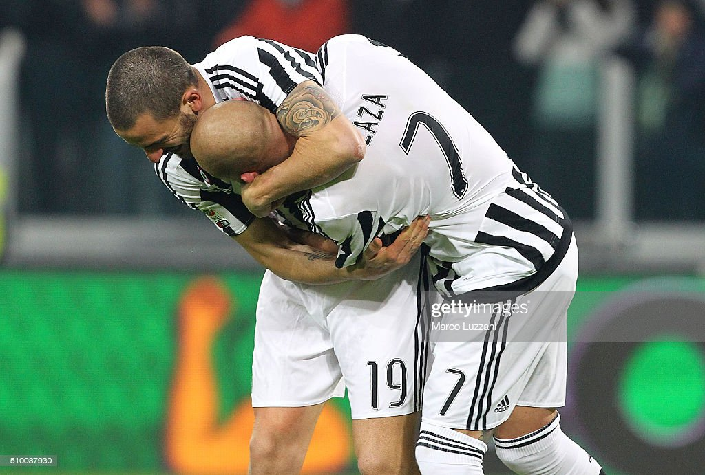 Leonardo Bonucci (L) and Simone Zaza (R) of Juventus FC celebrate a victory at the end of the Serie A match between and Juventus FC and SSC Napoli at Juventus Arena on February 13, 2016 in Turin, Italy.