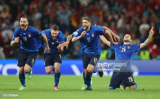 Leonardo Bonucci, Andrea Belotti, Domenico Berardi and Rafael Toloi of Italy celebrate following their team's victory in the penalty shoot out after...