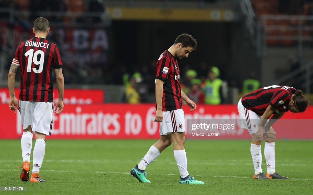 Leonardo Bonucci, Giacomo Bonaventura and Ricardo Rodriguez of AC Milan show their dejection at the end of the serie A match between AC Milan and US Sassuolo at Stadio Giuseppe Meazza on April 8, 2018 in Milan, Italy.
