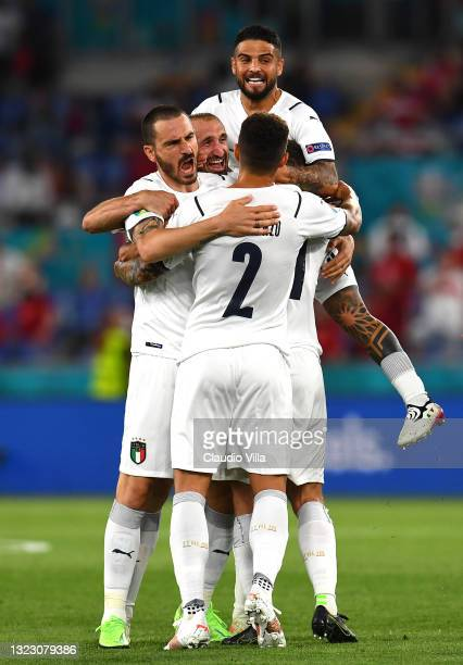 Leonardo Bonucci, Giorgio Chiellini, Lorenzo Insigne and Giovanni Di Lorenzo of Italy celebrate their side's first goal, an own goal by Merih Demiral...