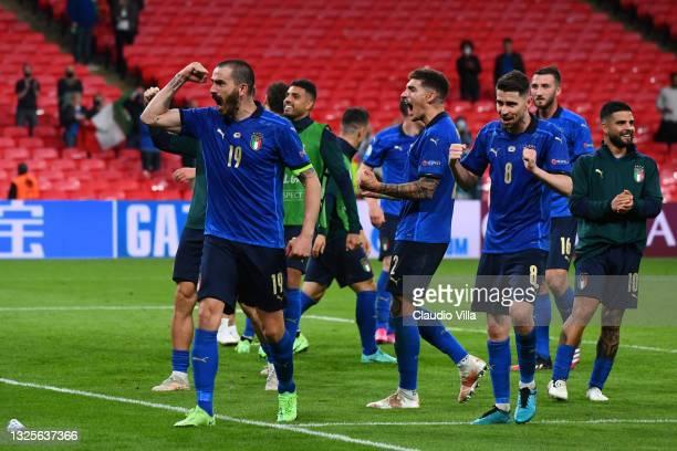Leonardo Bonucci, Giovanni Di Lorenzo and Jorginho of Italy celebrates after victory in the UEFA Euro 2020 Championship Round of 16 match between...