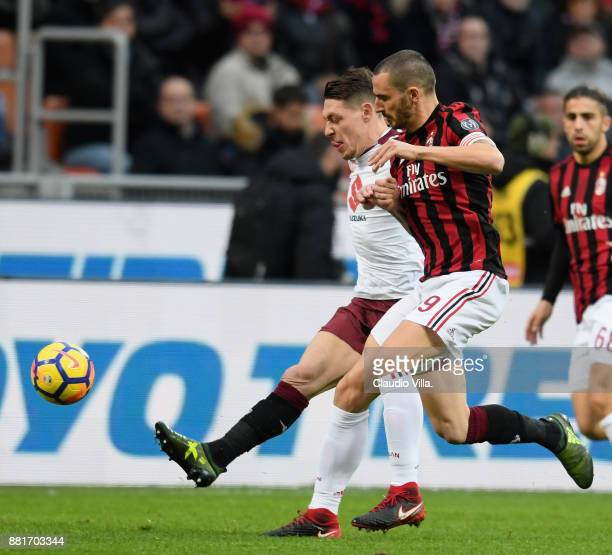 Leonardo Bonucci of AC Milan and Andrea Belotti of Torino FC compete for the ball during the Serie A match between AC Milan and Torino FC at Stadio...