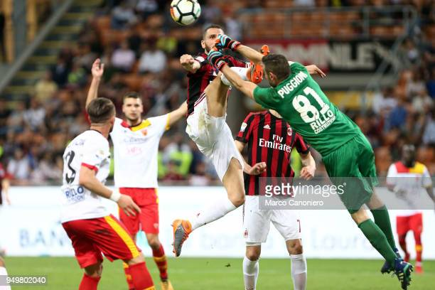 Leonardo Bonucci of Ac Milan and Christian Puggioni of Benevento Calcio in action during the Serie A football match between AC Milan and Benevento...